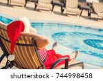 santa claus near the pool... | Shutterstock . vector #744998458
