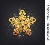 glitter covered gold snowflake... | Shutterstock .eps vector #745006579