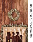 decorated fireplace on the... | Shutterstock . vector #745010308
