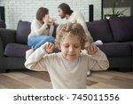 little boy puts fingers in ears ... | Shutterstock . vector #745011556