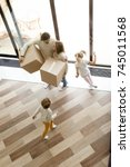 family and children moving into ... | Shutterstock . vector #745011568