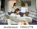happy dad and son reading... | Shutterstock . vector #745011778
