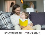 happy father and son holding... | Shutterstock . vector #745011874