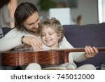young father teaching little... | Shutterstock . vector #745012000