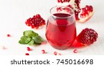 a glass of pomegranate juice... | Shutterstock . vector #745016698