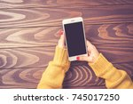 female hands in warm sweater... | Shutterstock . vector #745017250