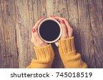 female hands in warm sweater... | Shutterstock . vector #745018519