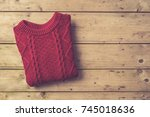 woman's warm sweater on an old... | Shutterstock . vector #745018636