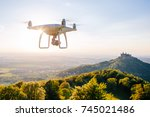 copter drone flying at sunset... | Shutterstock . vector #745021486