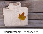 folded white pullover with roll ... | Shutterstock . vector #745027774