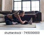slim sportswoman in sportswear... | Shutterstock . vector #745030003