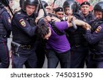 the arrest of a protesting man... | Shutterstock . vector #745031590