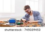 man disassembling smartphone in ... | Shutterstock . vector #745039453