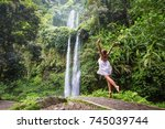 woman meditating doing yoga... | Shutterstock . vector #745039744
