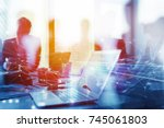 teamwork works with a laptop.... | Shutterstock . vector #745061803