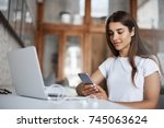 young happy woman using a smart ... | Shutterstock . vector #745063624