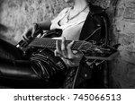 woman's hands playing guitar.... | Shutterstock . vector #745066513