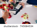 man paying for flowers with his ...   Shutterstock . vector #745084534