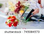 credit card payment. florist... | Shutterstock . vector #745084573