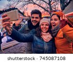 friends enjoying christmas... | Shutterstock . vector #745087108