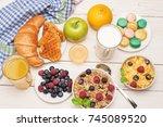 breakfast served with orange... | Shutterstock . vector #745089520