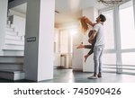 romantic couple at home.... | Shutterstock . vector #745090426