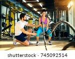 fitness woman in training doing ... | Shutterstock . vector #745092514