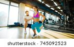 fitness flexible girl doing leg ... | Shutterstock . vector #745092523