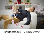 tired father sleeping with baby ... | Shutterstock . vector #745093990