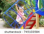 adorable little girl on... | Shutterstock . vector #745103584