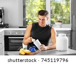 man preparing protein shake in... | Shutterstock . vector #745119796