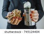 woman hands with an iron jar... | Shutterstock . vector #745124404