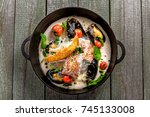 bowl of delicious seafood meal... | Shutterstock . vector #745133008