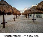 row of outdoor beach umbrellas. ... | Shutterstock . vector #745159426