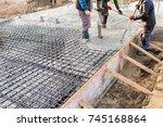 pouring concrete slab  ...   Shutterstock . vector #745168864