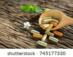 capsules powder from herbs on... | Shutterstock . vector #745177330