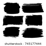 set of black ink brush strokes... | Shutterstock .eps vector #745177444