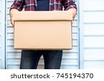 young man holding a moving... | Shutterstock . vector #745194370