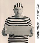Small photo of portrait of a man prisoner in prison garb in retro style
