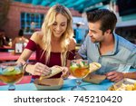 romantic couple eating street... | Shutterstock . vector #745210420