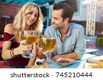romantic couple making cheers... | Shutterstock . vector #745210444