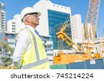 engineer man in helmet and... | Shutterstock . vector #745214224