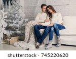 happy couple. christmas... | Shutterstock . vector #745220620