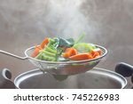 The Steam From The Vegetable...