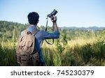 backpacker asian man hold the... | Shutterstock . vector #745230379