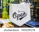 open sign broad through the... | Shutterstock . vector #745239178