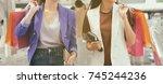 women hold shopping bag after... | Shutterstock . vector #745244236