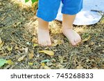 two small baby legs in summer... | Shutterstock . vector #745268833