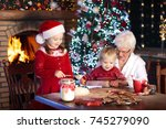grandmother and children baking ... | Shutterstock . vector #745279090