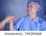 Small photo of Holding hands Asian senior or elderly old woman patient with love, care, encourage and empathy at hospital